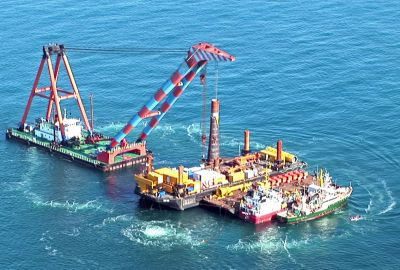 Aerial phot of pile driving with active bubble curtain